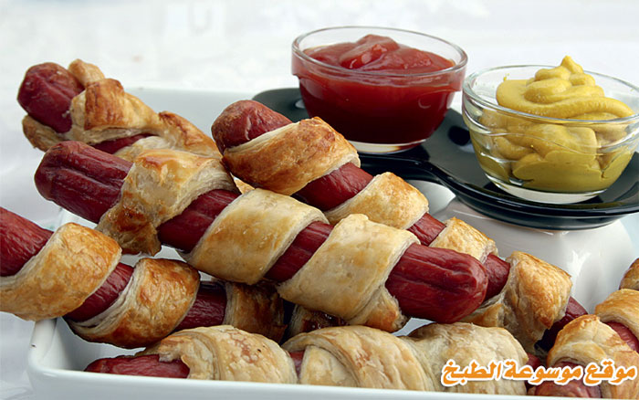 http://www.qassimy.com/up/users/qassimy/how_to_make_a_recipe_for_Fingers_of_hot_dogs_with_puff_paste.jpg